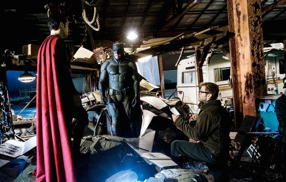 Batman in wrecked Batmobile